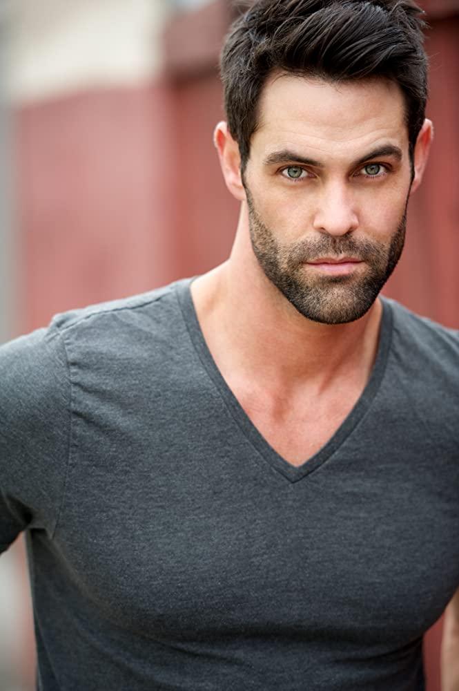 Jason Shane Scott as Travis Green