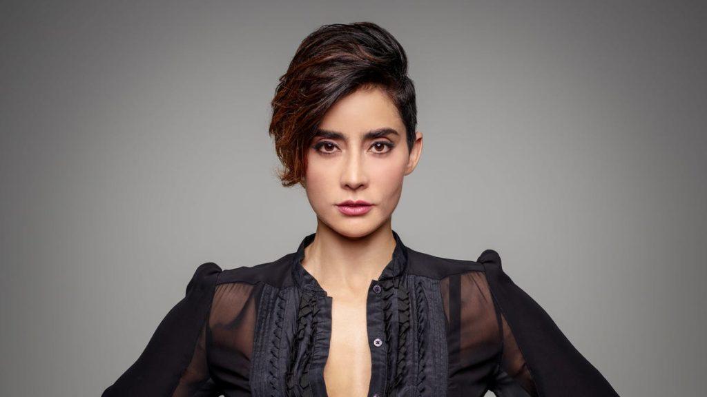 Paola Núñezas Rita Secada, head of AMMO, Mike's ex-girlfriend
